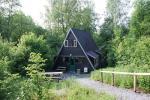 Foto voorkant bungalow vanuit de tuin
